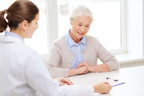An elderly woman having a consultation with a doctor | Medigap Plans