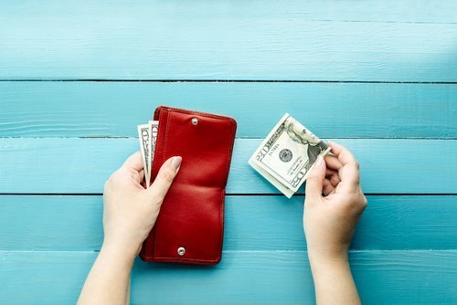 A wallet with some money and a twenty-dollar bill | Cafeteria Plan | Midwest Employee Benefits